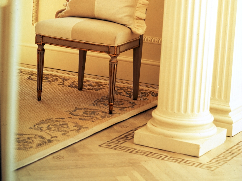 Floor border Greek Key in gold, Sisal Acanthus border in gray, interior design by Mary Douglas Drysdale