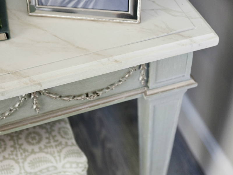 Faux marbre table top, gesso glazed table base with silver leaf accents. Gustavian Swedish colors. Interior design by Marika Meyer Interiors