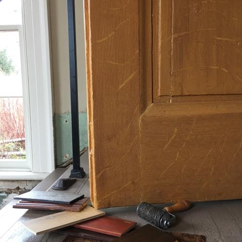 Lincoln Cottage, faux bois, quarter sawn oak woodgrain, front doors with artist tools