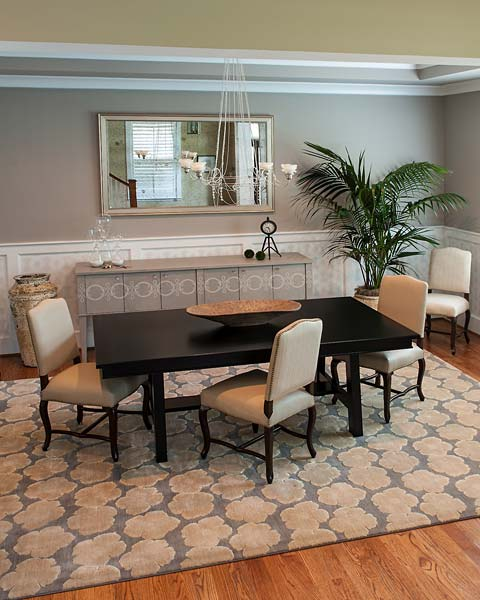 dining room with painted wainscot and console