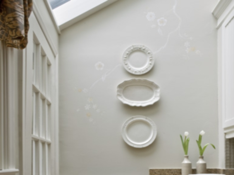 Stylized Botanical Mural in kitchen with white plates as artwork.